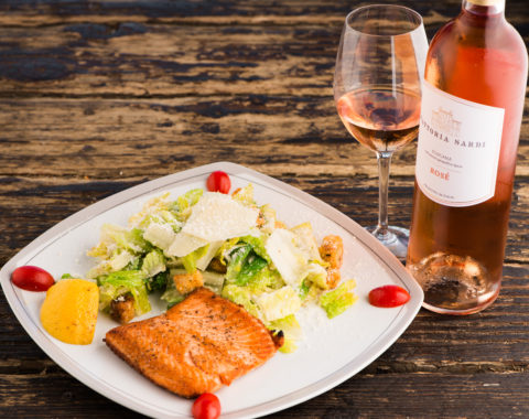 Cesare salad: Create your own salad. Grilled wild sustainable salmon served with Cesare salad, organic romaine lettuce with homemade caesar salad dressing and croutons topped with Parmesan cheese. Wine pairing Tuscan Rosé Fattoria Sardi.