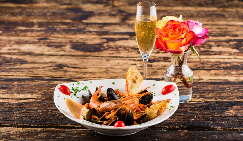 Cioppino: Cioppino, fresh sustainable wild salmon, monkfish, clams, mussels, calamari and prawns in a light tomato garlic broth
