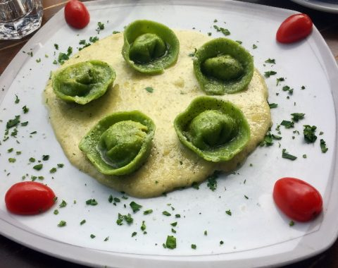 Cappelletti Verdi: Homemade spinach infused pasta filled with mortadella, ricotta, pistachio and zest of lime, served on a cream fennel sauce