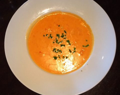 Crab Bisque: Homemade Rock crab Bisque with zucchini and bell pepper purée