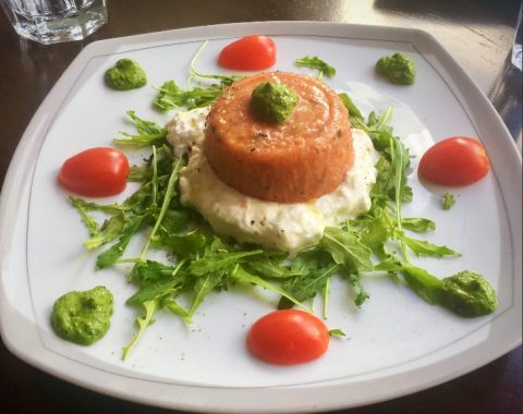 Mousse Di Pomodoro: Homemade tomato mousse with marjoram, garlic and basil, served on top of fresh Italian straciatella cheese and arugula with basil and olive oil dressing
