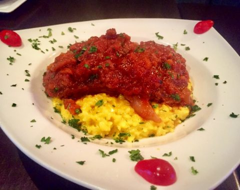 Ossobuco: Braised veal shank served with saffron risotto